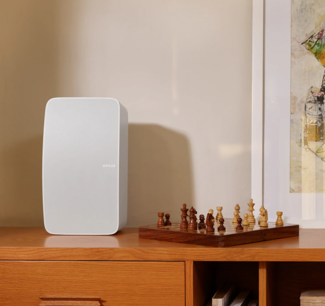 SONOS Five in white on a cabinet with a chess set beside it.