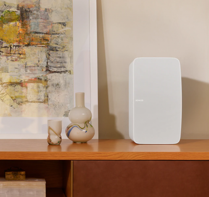 SONOS Five in white on a cabinet beside a vase